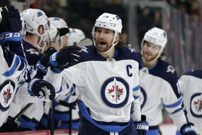 Winnipeg Jets right wing Blake Wheeler celebrates after scoring a goal on the Minnesota Wild in the first period of an NHL hockey game Saturday, Dec. 21, 2019, in St. Paul, Minn. (AP Photo/Andy Clayton-King)</p>