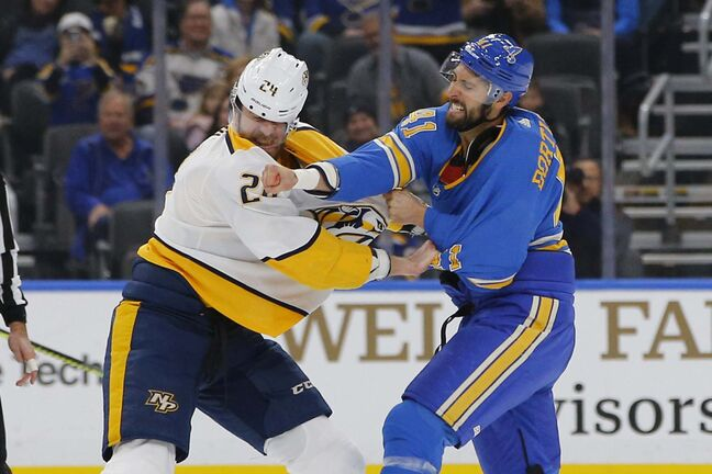 St. Louis Blues' Robert Bortuzzo (right) gets a shot in against Nashville's Jarred Tinordi on Saturday. (Billy Hurst / The Associated Press files)</p>