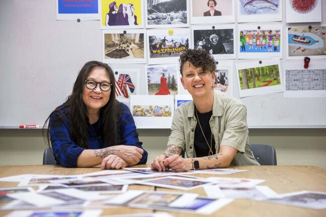 Artist Lita Fontaine (left) and art teacher Barb Bottle at Margaret Park School with the MAWA art cards. (Mikaela MacKenzie / Winnipeg Free Press)
