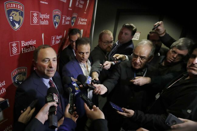 National Hockey League Commissioner Gary Bettman, left, speaks to members of the media , Saturday, March 7, 2020, in Sunrise, Fla. (AP Photo/Wilfredo Lee)</p>
