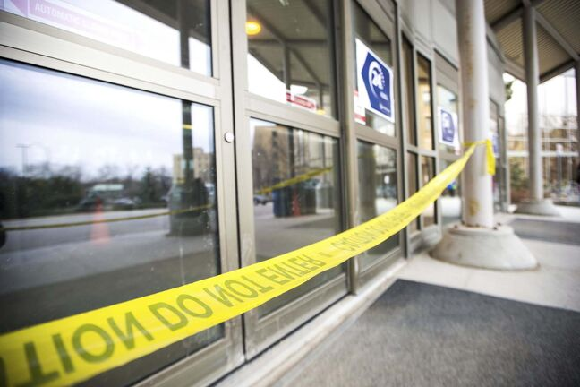 MIKAELA MACKENZIE / WINNIPEG FREE PRESS</p><p>Signage and tape denoting staff and patient entrances at the St. Boniface Hospital in Winnipeg on Wednesday, April 1, 2020. New staff screening measures are being put into place today.Winnipeg Free Press 2020</p>