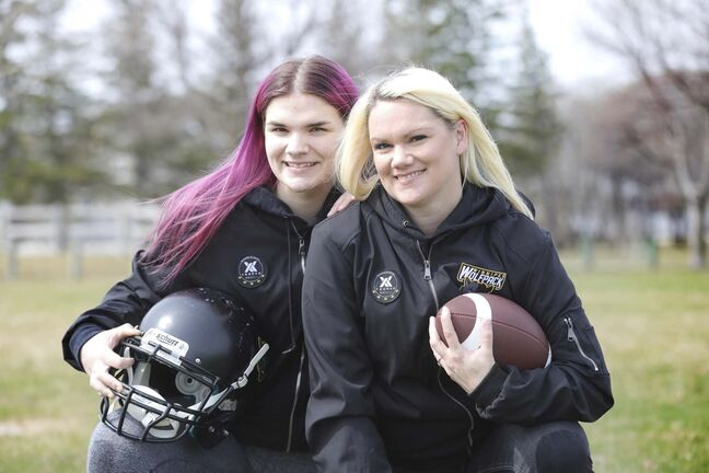 Julianna Raposo (left) and mom Jennifer play women's tackle football together.