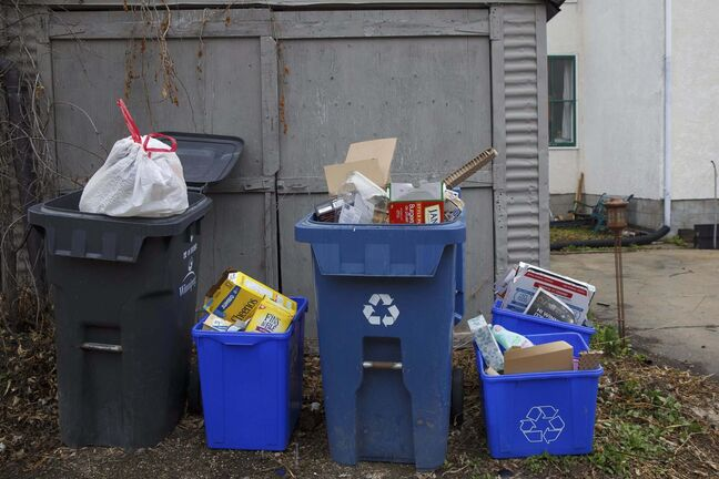 MIKE DEAL / WINNIPEG FREE PRESSOverflowing garbage and recycling bins in a back lane in Winnipeg.The changes are evident, instead of sitting down for dinner at a restaurant it's takeout in plastic or cardboard packages. Instead of grocery shopping using refillable containers, it's back to single-use bags to keep things sterile. The pandemic has changed people's perspective on where germs can be introduced, and understandably it's made people much more cautious — but it also means more waste.See Sarah's story200514 - Thursday, May 14, 2020.</p>