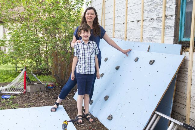 Rebecca Chambers and her seven-year-old son, Henry, are working on a climbing wall.</p>