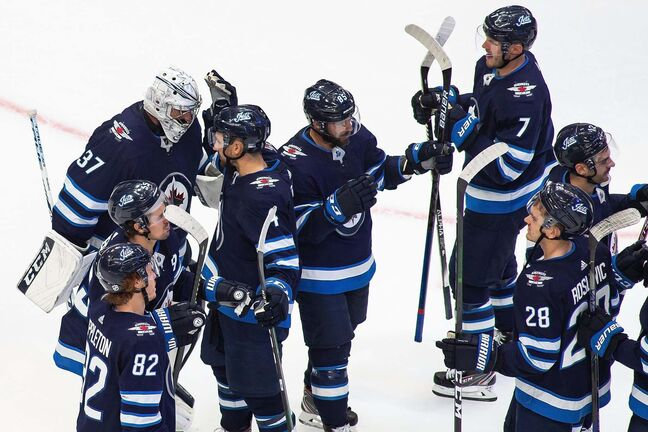 The Winnipeg Jets celebrate their win over the Vancouver Canucks in NHL exhibition game action in Edmonton, on Wednesday July 29, 2020. THE CANADIAN PRESS/Codie McLachlan</p>