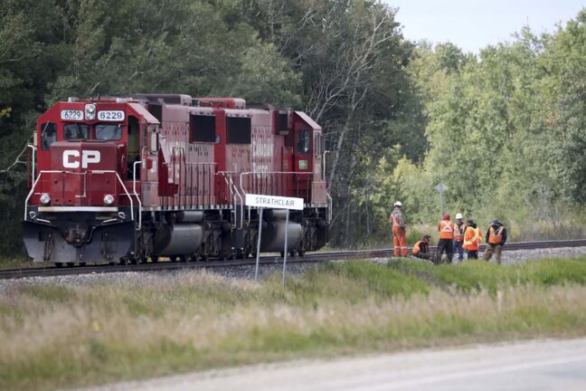 Canadian Pacific locomotives sit on the track just east of Strathclair at the scene of a collision with a passenger van on Tuesday afternoon that claimed the lives of three men.