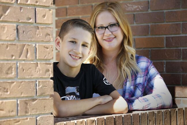 JOHN WOODS / WINNIPEG FREE PRESSJohn Pritchard School grade 6 student Connor Gylywoychuk, who does not have COVID-19, and his mother Breanne are photographed outside their home in Winnipeg Thursday, September 17, 2020. Gylywoychuk's son was sent home from school as a precaution when a grade 7 student was found to be COVID-19 positive.</p><p>Reporter: Abas</p>