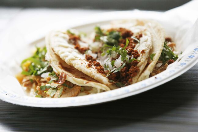 photos by JOHN WOODS / WINNIPEG FREE PRESS</p><p>Two-dollar tacos from BMC Market on Osborne Street</p>