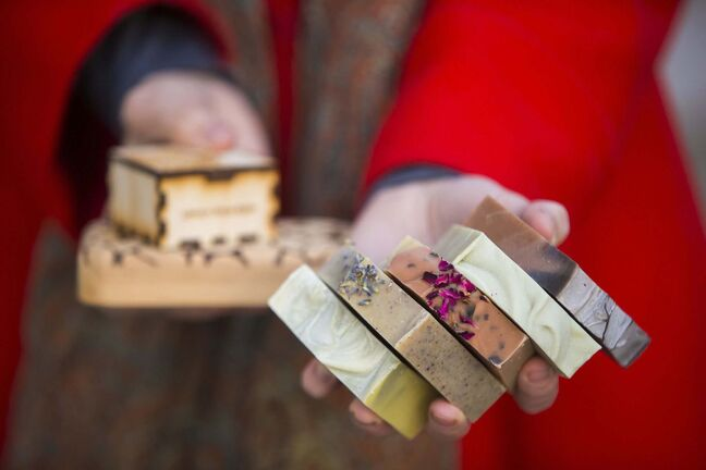 MIKAELA MACKENZIE / WINNIPEG FREE PRESS</p><p>Rebecca Haverluck, owner of Art Soap Life, poses for a portrait with her products in her front yard in Winnipeg on Thursday, Dec. 3, 2020. She is one of the vendors on the new site goodlocal.ca, a website dedicated to selling local Manitoba products, which had to halt all orders because they couldn't keep up with demand. For Cody story.</p><p>Winnipeg Free Press 2020</p>