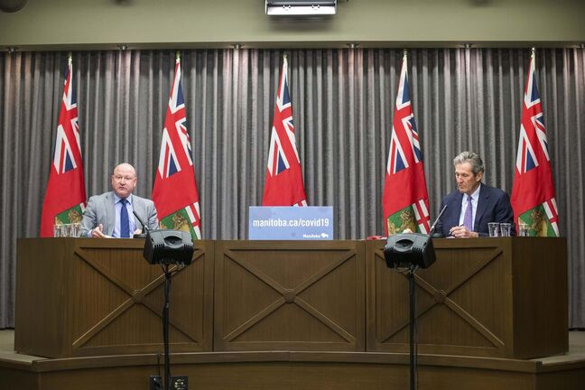 MIKAELA MACKENZIE / WINNIPEG FREE PRESS</p><p>Dr. Brent Roussin, chief provincial public health officer (left), and Premier Brian Pallister speak at a press conference at the Manitoba Legislative Building in Winnipeg on Friday, Jan. 15, 2021. For Carol Sanders story.</p><p>Winnipeg Free Press 2021</p>
