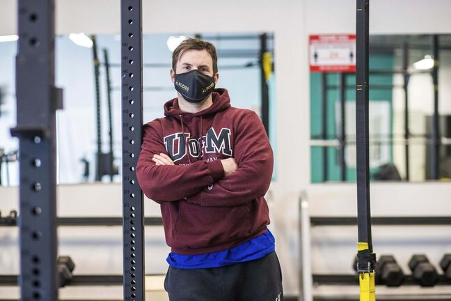 MIKAELA MACKENZIE / WINNIPEG FREE PRESS</p><p>Dino Camiré, owner of One Family Fitness, poses for a portrait in the gym in Winnipeg on Tuesday, Feb. 9, 2021. For Temur story.</p><p>Winnipeg Free Press 2021</p>