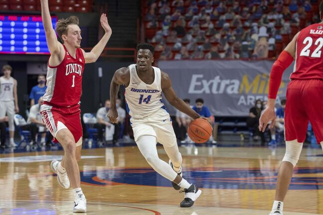 Midway through the 2018-19 season, Emmanuel Akot (14) announced he had transferred to the Boise State Broncos.