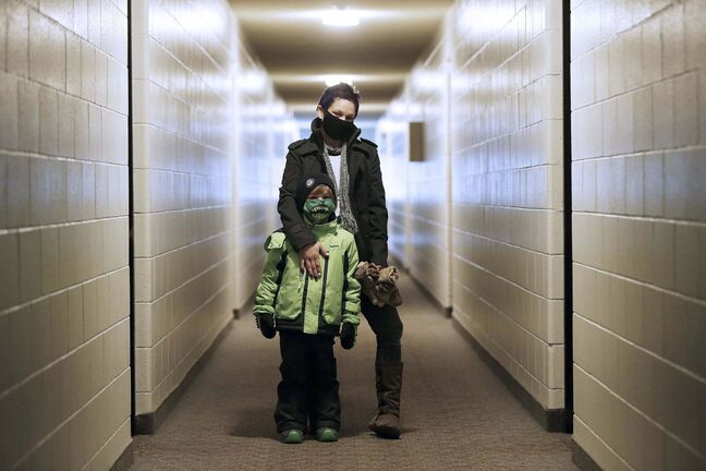 JOHN WOODS / WINNIPEG FREE PRESS</p><p>Charity McLellan and her son, Jaxon, at their apartment building on David Street. The new owners of the Fairlane Apartments have informed McLellan that her monthly rent will be going from $806 to $1400.</p>