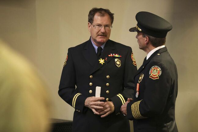 RUTH BONNEVILLE / WINNIPEG FREE PRESS United Firefighters of Winnipeg President Alex Forrest talks with Fire Paramedic Service Chief John Lane, after the graduation of Winnipeg Fire Paramedic Service Firefighter Recruit Class #1802 at The Metropolitan Entertainment Centre Friday. See Ryan Thorpe story. June 22, 2018</p>