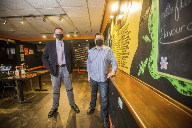 MIKAELA MACKENZIE / WINNIPEG FREE PRESS</p><p>Dave MacKay, owner (left), and Jeff Klause, president pose for a portrait at Little Bones Wings in Winnipeg on Thursday, Feb. 25, 2021. Restaurants are dealing with across-the-board price increases from suppliers on top of everything else. For Martin Cash story.</p><p>Winnipeg Free Press 2021</p>