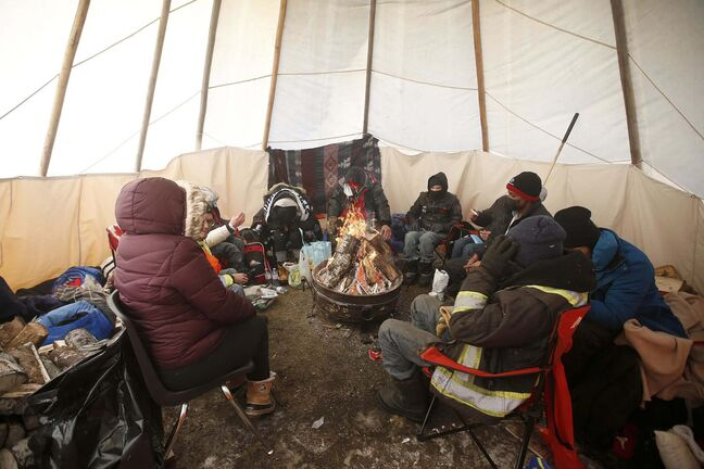 JOHN WOODS / WINNIPEG FREE PRESSPeople warm up in a teepee at the Anishinative camp at Thunderbird House in Winnipeg Sunday, February 14, 2021.</p><p>Reporter: Sellar</p>