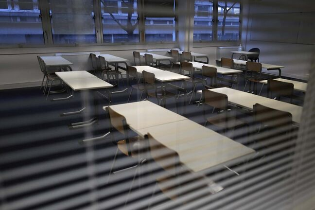 An empty classroom is pictured at the MHS, Meo High School private college, in Paris on Tuesday, Feb. 9, 2021. More than three dozen police officers descended on the small private school, blocked students inside their classrooms, took photos everywhere, even inside the refrigerator, and grilled the school director in her office. Such operations illustrate French efforts to fight extremism as lawmakers prepare to vote on a bill aimed at snuffing it out. (AP Photo/Francois Mori)</p>
