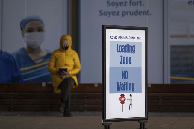 Daniel Crump / Winnipeg Free Press. A person waits outside the RBC Convention Centre downtown after receiving their COVID-19 vaccination Wednesday afternoon. March 31, 2021.</p>