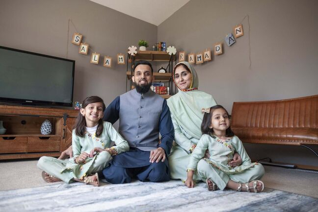 Daniel Crump / Winnipeg Free Press. (L to R) Ayza Waleed, Waleed Waleed, Asra Waleed and Sarah Waleed sit in front of their decorated ramadan corner in their living room. April 10, 2021.</p>