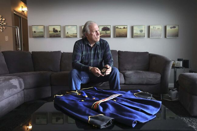RUTH BONNEVILLE / WINNIPEG FREE PRESS</p><p>LOCAL - police hate speech</p><p>Portrait of former WPS inspector Stan Tataryn, with his retirement police badge and his Winnipeg Police jacket, taken at his home on Wednesday.</p><p>Former WPS inspector Stan Tataryn has launched a House of Commons petition to add police to those who can be subject to hate speech. He says grassroots groups in Winnipeg are causing a wedge last seen in the 1970s, trying to push police out of the community by vilifying them and making them unable to have the moral authority to de-escalate situations, thus increasing the risk of a gun being pulled. He feels protest signs like