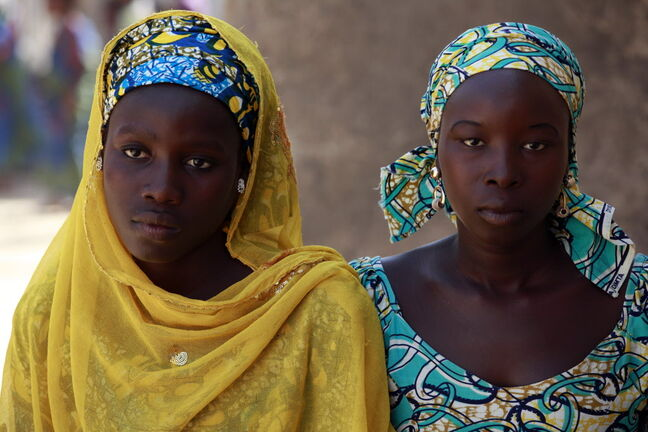 Nigerians Joy Bishara (left) and Hadiza Fali escaped from Boko Haram by jumping off a truck.