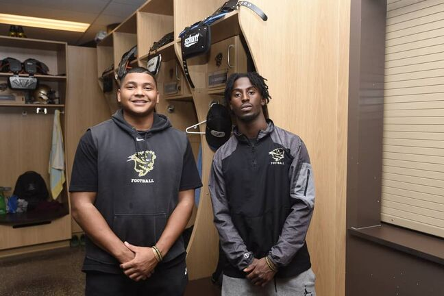 U of M Bisons linebacker, Nick Thomas, left, and receiver, Adbul-Karim Gassama are eager to get back on the field for training camp Saturday.