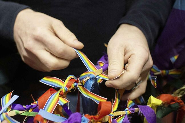 Rainbow ribbons are tied on a two spirit staff as attendees gather at a vigil to remember the victims of Bruce McArthur at a Toronto church on Sunday, February 10, 2019. THE CANADIAN PRESS/Chris Young