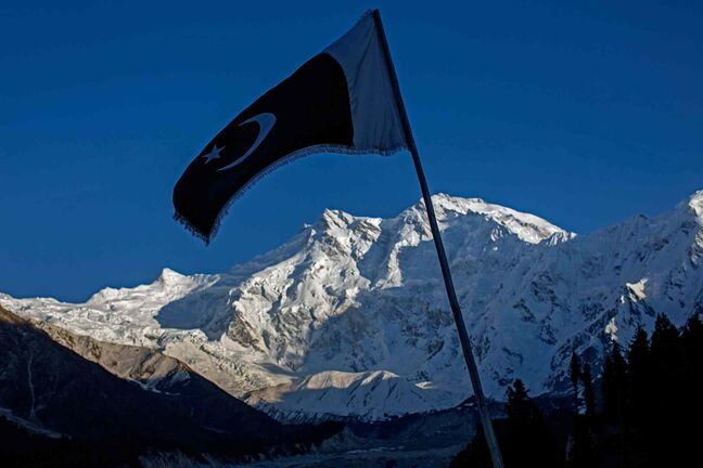 The flag of Pakistan waves in the breeze as the sun sets on the world's ninth highest mountain, Nanga Parbat, at the mountain resort of Fairy Meadows in Pakistan on Friday, June 13, 2014. Last year 10 international climbers on an expedition to the summit of Nanga Parbat were murdered by Taliban gunmen, an event which has caused the number of international visitors to the mountain to plummet.