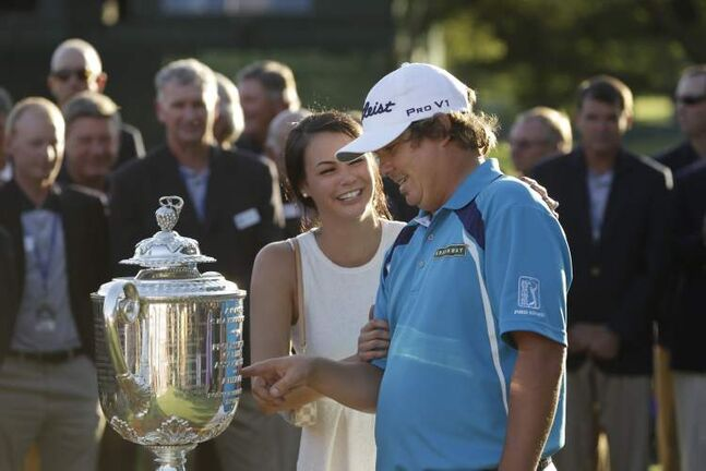 Jason Dufner admires the Wanamaker Trophy with his wife Amanda after winning the PGA Championship Sunday.
