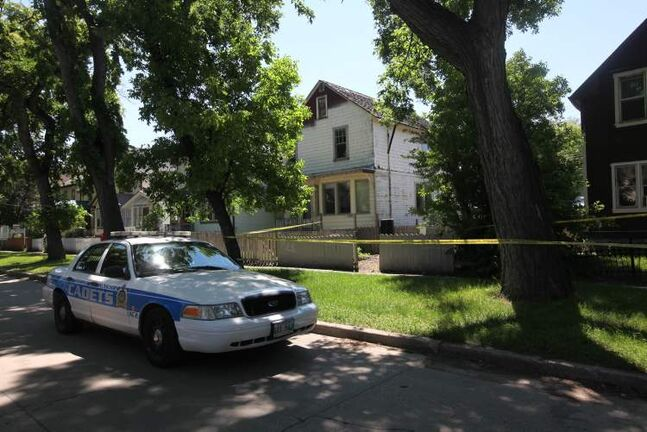 Police officers guard the scene of a stabbing  400 block of Pritchard Ave. Saturday afternoon.