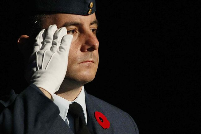 A soldier salutes during The Last Post at the Remembrance Day service at the RBC Convention Centre Winnipeg.