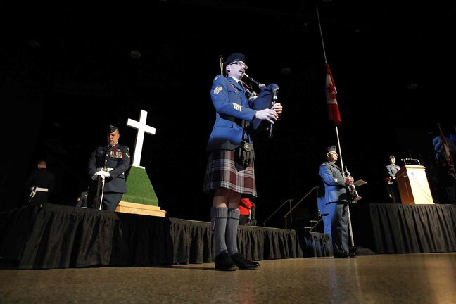 A piper plays a lament during the Remembrance Day service at the RBC Convention Centre Winnipeg.