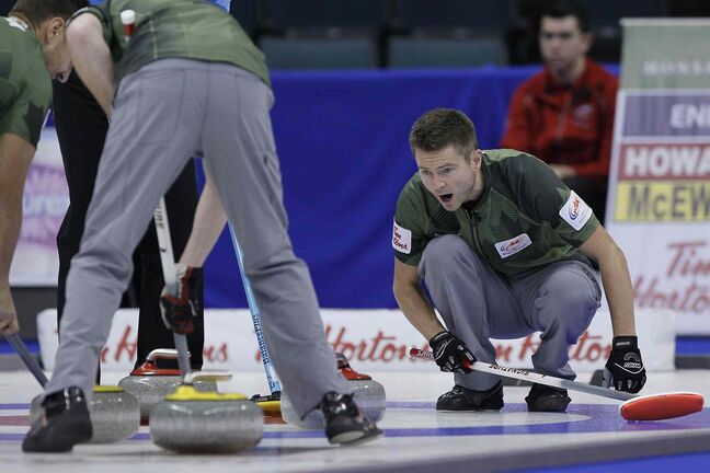 Skip Mike McEwen calls to his sweepers during draw 10 against Glenn Howard at the 2013 Roar Of The Rings championship in Winnipeg, Wednesday.