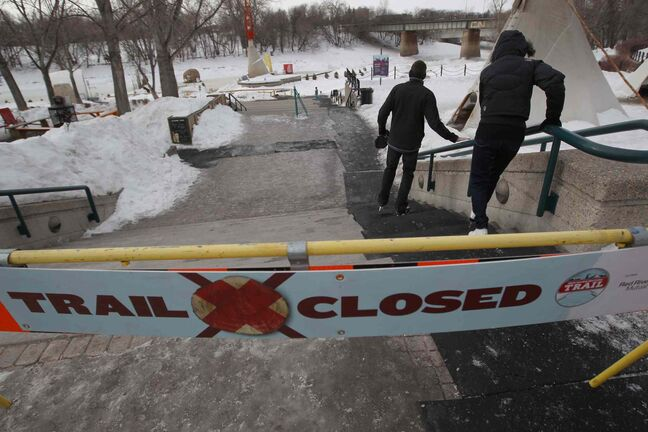 Two renegade skaters take to the ice at the Forks Tuesday even after the main river trail was closed for the season.