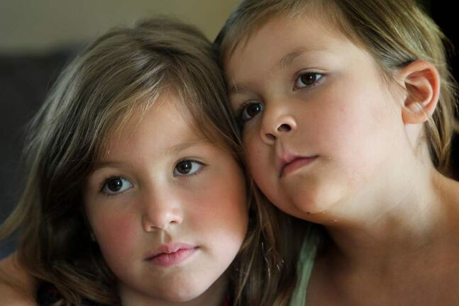 Close sisters, six year old Sopha Penne (right) and Alexis - 7 years share and intimate embrace. The siblings became close after enduring long stints in the children's hospital after Sophia was diagnosed with cancer when she was 2 and a half years old.     