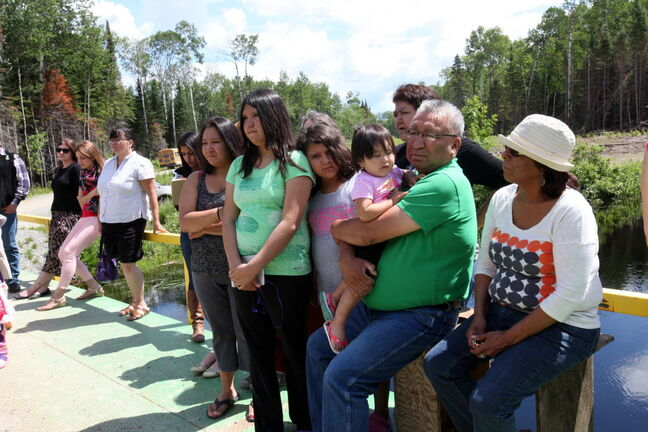 Residents of Shoal Lake 40 First Nation take part in event marking the 100th anniversary of the flooding of their land to provide water for the City of Winnipeg.