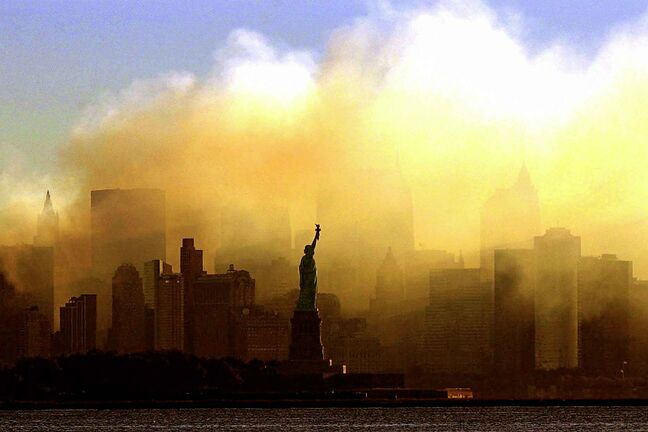 In this Saturday, Sept. 15, 2001 file photo, the Statue of Liberty stands in front of a smoldering lower Manhattan at dawn, seen from Jersey City, N.J. The Sept. 11, 2001 terrorist attacks on the United States nearly 20 years ago precipitated profound changes in America and the world. (Dan Loh / The Associated Press files)