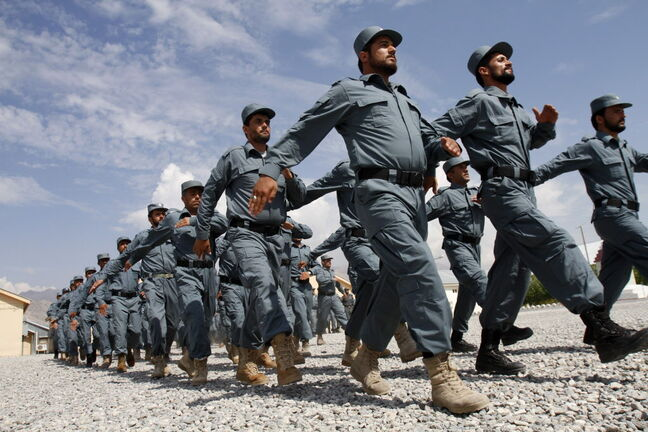Afghan national police officers march during a graduation ceremony at a National Police training center in Laghman province, east of Kabul, Afghanistan. Over 148 National police officers graduated after receiving 4 months of training in Laghman. (AP Photo/Rahmat Gul)