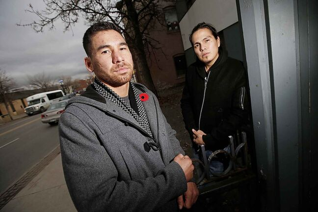 Jonathan Meikle, left, and Matthew Shorting intervened in a bus attack Sunday when they were riding the 170 bus on Main St. at St Mary. The friends say they intervened when another indigenous man made racial slurs against a black passenger. Meikle was stabbed in the leg when the man pulled a knife. The two, both members of the Bear Clan, held the man until police arrived.