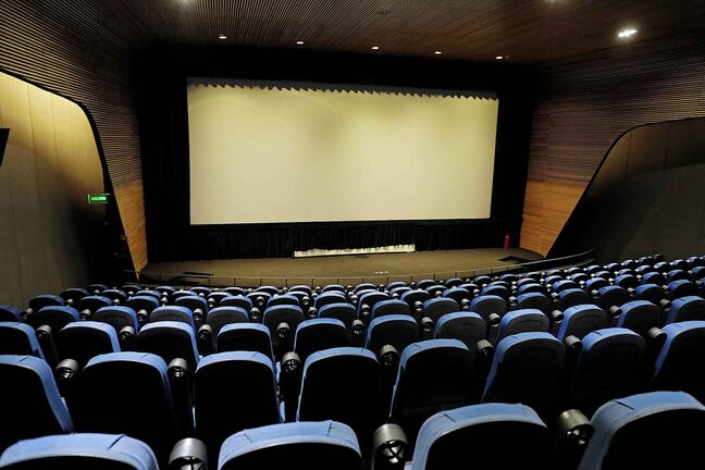 A theater sits empty shortly before the start of a scheduled film showing, attended by a half dozen people, at the Cineteca Nacional, Mexico's film archive, in Mexico City, Wednesday, Aug. 12, 2020. After being closed for nearly five months amidst the ongoing coronavirus pandemic, movie theaters in the capital reopened Wednesday at 30% capacity. (AP Photo/Rebecca Blackwell)