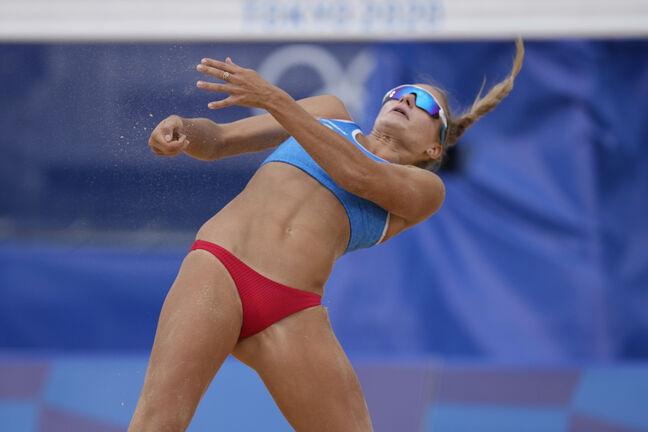 Svetlana Kholomina, of the Russian Olympic Committee, recovers from a shot during a women's beach volleyball match against Australia at the 2020 Summer Olympics, Friday, July 30, 2021, in Tokyo, Japan. (AP Photo/Petros Giannakouris)