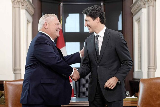 Prime Minister Justin Trudeau shakes hands with the Premier of Ontario Doug Ford at his office in the West Block of Parliament Hill in Ottawa on Friday. (Adrian Wyld / The Canadian Press files)