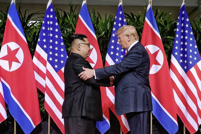 Top leader of the Democratic People's Republic of Korea (DPRK) Kim Jong Un, left, shakes hands with U.S. President Donald Trump in Singapore on June 12, 2018. (The Straits Times/Xinhua/Zuma Press/TNS)