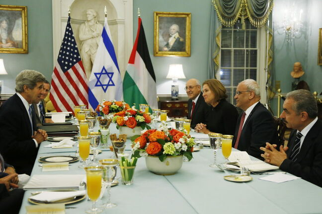 U.S. Secretary of State John Kerry (left) sits across from Israel's Justice Minister and chief negotiator Tzipi Livni (third right), Palestinian chief negotiator Saeb Erekat (second right), Yitzhak Molcho, an adviser to Israeli Prime Minister Benjamin Netanyahu (fourth right), and Mohammed Shtayyeh, aide to Palestinian President Mahmoud Abbas (right), at an Iftar dinner, which celebrates Ramadan in late July.