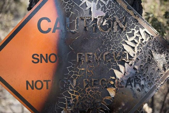 Paint peels from a sign burned in the Rim fire in the Stanislaus National Forest along Highway 120 near Yosemite National Park.