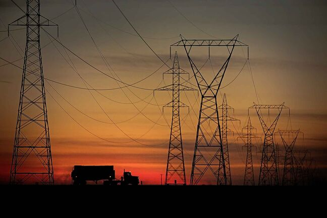 A truck passes some power transmission lines  and a sunset on the northwest perimeter in Winnipeg Thursday, September 22, 2011. (John Woods/Winnipeg Free Press