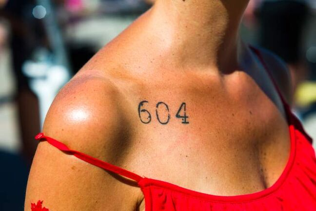 "His 'n hers matching house numbers — 604 ""It's our house address — and our commitment. Instead of having a big wedding, we bought a house. He got his in Vegas, and then I went six months later, to the same artist."" Total tats: 4"