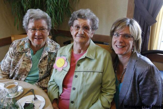 Stella Baran, 101, with daughter Nettie Kowbel (left) and granddaughter Donna Wankling, lives in her own suite, works out.