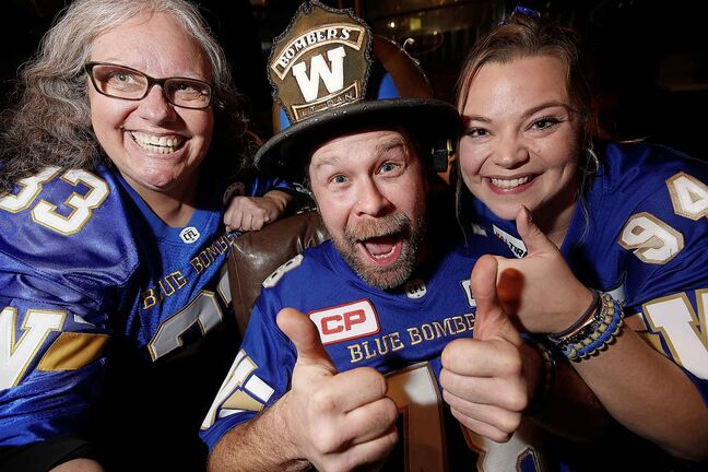 From left, Claudia Byczek, Dan LeBlanc, aka Lt Dan, and Fraser Olson who are leaving for Calgary tomorrow to support the Winnipeg Blue Bombers in the Grey Cup.