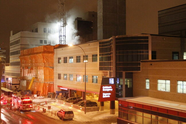 Firefighters fight a fire in March in the wing of the Children's Hospital currently under construction.